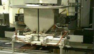 Chocolate  dispensing machine with two Exlar actuators